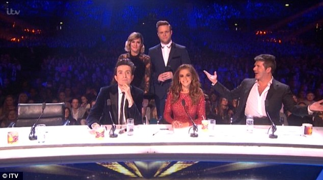 Defending their show: Caroline Flack and Olly Murs' best efforts to allow Saturday night's X Factor live final run without a glitch, the show was fraught with technical issues