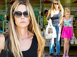 UK CLIENTS MUST CREDIT: AKM-GSI ONLY\nEXCLUSIVE: Calabasas, CA - Denise Richards cooled off in Calabasas by taking off her shirt and enjoying some fro-yo with her daughters Sam and Lola at Menchie's Frozen Yogurt.\n\nPictured: Denise Richards\nRef: SPL1195634  131215   EXCLUSIVE\nPicture by: AKM-GSI / Splash News\n\n