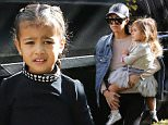Nori goes to a private party with Kourtney and her kids and brings flowers with briads in her hair. Sunday, December 13, 2015. X17online.com