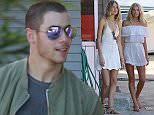 EXCLUSIVE: Nick Jonas arrives via helicopter and gets greeted by Victoria Secret Angeles in St Barth.  Ref: SPL1195142  131215   EXCLUSIVE Picture by: Splash News  Splash News and Pictures Los Angeles: 310-821-2666 New York: 212-619-2666 London: 870-934-2666 photodesk@splashnews.com