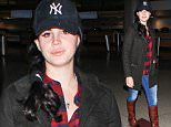 LOS ANGELES, CA - DECEMBER 13: Lana Del Rey is seen at LAX on December 13, 2015 in Los Angeles, California.  (Photo by GVK/Bauer-Griffin/GC Images)
