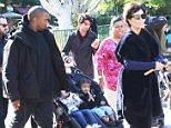 Kanye West and Kris Jenner take Nori and Penelope tro Disneyland on monday dec 14, 2015 X17online.com
