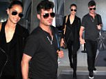 EXCLUSIVE: Robin Thicke and girlfriend April Love Geary hold hands as they stroll through the terminal at LAX airport in Los Angeles, CA.\n\nPictured: Robin Thicke and April Love Geary\nRef: SPL1196350  141215   EXCLUSIVE\nPicture by: Diabolik / Splash News\n\nSplash News and Pictures\nLos Angeles: 310-821-2666\nNew York: 212-619-2666\nLondon: 870-934-2666\nphotodesk@splashnews.com\n