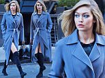 EXCLUSIVE: Gigi Hadid seen leaving her Maybelline photo shoot at Chalk Point Kitchen in a blue Iris Von Arnim trench coat and knee high boots.\n\nPictured: Gigi Hadid\nRef: SPL1195486  141215   EXCLUSIVE\nPicture by: TK / Splash News\n\nSplash News and Pictures\nLos Angeles: 310-821-2666\nNew York: 212-619-2666\nLondon: 870-934-2666\nphotodesk@splashnews.com\n