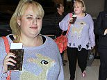 An exhausted Rebel Wilson arrives at LAX in a distressed knitted sweater bearing the image of a fawn. December 14, 2015 X17online.com
