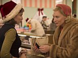 """This photo provided by The Weinstein Company shows, Rooney Mara, left, as Therese Belivet, and Cate Blanchett, as Carol Aird, in a scene from the film, """"Carol.""""  The film was nominated for a Golden Globe award for best motion picture drama on Thursday, Dec. 10, 2015. Mara and Blanchett were also each nominated for best actress in a drama film. The 73rd Annual Golden Globes will be held on Jan. 10, 2016. (Wilson Webb/The Weinstein Company via AP)"""