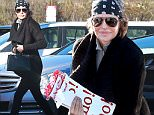 """Picture Shows: Lisa Rinna  December 14, 2015\n \n Actress Lisa Rinna spotted out and about in Studio City, California. \n \n Lisa was rocking her signature bandana and showed off Christmas gift bags that said """"Ho! Ho! Ho!""""\n \n Exclusive - All Round\n UK RIGHTS ONLY\n \n Pictures by : FameFlynet UK © 2015\n Tel : +44 (0)20 3551 5049\n Email : info@fameflynet.uk.com"""