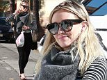 Hilary Duff shopping in Studio City wearing flip flops, black leggings and a balck and white striped top\nFeaturing: Hilary Duff\nWhere: Los Angeles, California, United States\nWhen: 14 Dec 2015\nCredit: WENN.com