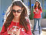 Picture Shows: Mila Kunis  December 14, 2015\n \n 'Bad Moms' actress and busy mom Mila Kunis stops for coffee in Studio City, California. \n \n Mila was showing off her love as she was wearing a shirt that said 'Love All' while her phone case said 'Love'.\n \n Exclusive - All Round\n UK RIGHTS ONLY\n \n Pictures by : FameFlynet UK © 2015\n Tel : +44 (0)20 3551 5049\n Email : info@fameflynet.uk.com