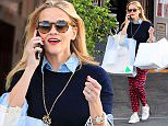 Reese Witherspoon takes holiday shopping seriously carrying massive bags after a successful holiday gift buying spree at Brentwood Country Mart Monday, December 14, 2015. X17online.com\nOK FOR WEB SITE AT 20PP\nMAGAZINES NORMAL FEES\nAny queries please call Lynne or Gary on office 0034 966 713 949 \nGary mobile 0034 686 421 720 \nLynne mobile 0034 611 100 011\nAlasdair mobile  0034 630 576 519