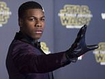 """Actor John Boyega attends the World Premiere of """"Star Wars: The Force Awakens"""", in Hollywood, California, on December 14, 2015.AFP PHOTO /VALERIE MACONVALERIE MACON/AFP/Getty Images"""