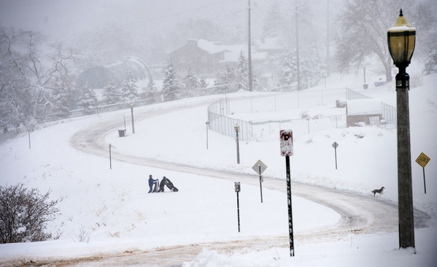 Youngsters head for the hills to sled in Salt Lake City as a major storm dumped snow through out the state, Monday, Dec. 14, 2015. (Steve Griffin/The Salt La...