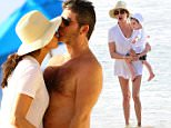 Simon Cowell get a kiss from Lauren Silverman while at the beach in Barbados \n\nPictured: Simon Cowell, Lauren Silverman\nRef: SPL1197674  161215  \nPicture by: PRIMADONNA/GEMAIRA/Splash News\n\nSplash News and Pictures\nLos Angeles: 310-821-2666\nNew York: 212-619-2666\nLondon: 870-934-2666\nphotodesk@splashnews.com\n