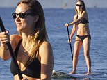 EXCLUSIVE: Olivia Wilde goes bikini paddleboarding on her Maui vacation.\n\nPictured: Olivia Wilde\nRef: SPL1195695  151215   EXCLUSIVE\nPicture by: starsurf / Splash News\n\nSplash News and Pictures\nLos Angeles: 310-821-2666\nNew York: 212-619-2666\nLondon: 870-934-2666\nphotodesk@splashnews.com\n