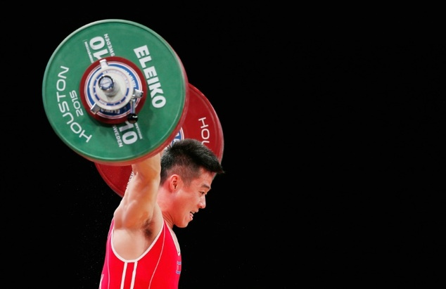 Kim Un Guk of North Korea competes in the men's 62kg weight class during the 2015 International Weightlifting Federation World Championships at the George R....