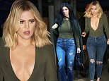 Khloe Kardashian leaving the studio in a daring low plunging top and it looks like she's weaing pasties to keep her in place after showing off her butt for a photo shoot. Is she trying to out do big sis Kim?   December 18, 2015 X17online.com