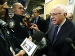 Bernie Sanders speaks to reporters in the media filing center after a Democratic presidential primary debate Saturday, Dec. 19, 2015, at Saint Anselm College in Manchester, N.H. (AP Photo/Michael Dwyer)