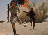 """This photo provided by Disney shows Daisey Ridley as Rey, left, and John Boyega as Finn, in a scene from the new film, """"Star Wars: The Force Awakens,"""" directed by J.J. Abrams. The movie releases in the U.S. on Dec. 18, 2015. (Film Frame/Disney/Copyright Lucasfilm 2015 via AP)"""
