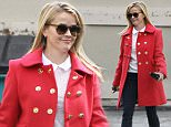 Please contact X17 before any use of these exclusive photos - x17@x17agency.com   Reese Witherspoon keeping warm in red and jeans running errands. Sunday, December 20, 2015 X17online.com