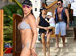 Simon Cowell, Lauren Silverman and son Eric are spotted on the beach riding jet skis while on holiday in Barbados\n\nPictured: Simon Cowell\nRef: SPL1199157  191215  \nPicture by:  GEMAIR/PRIMADONNA / Splash News\n\nSplash News and Pictures\nLos Angeles: 310-821-2666\nNew York: 212-619-2666\nLondon: 870-934-2666\nphotodesk@splashnews.com\n
