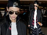 Ruby Rose attempts to cover her face with a 'Self Help' Novel following split in LA! The Orange is the New Black actor was seen dressed in leather jacket and baseball cap as she headed through LAX airport. Ruby held the book which is described as dazzling in its powerful simplicity and inspiring wisdom as she headed to the limo with her entourage!\n\nPictured: Ruby Rose\nRef: SPL1199319  201215  \nPicture by: Atlantic Images  / Splash News\n\nSplash News and Pictures\nLos Angeles: 310-821-2666\nNew York: 212-619-2666\nLondon: 870-934-2666\nphotodesk@splashnews.com\n