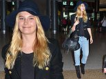 **EXCLUSIVE PHOTOS**  DECEMBER 20 2015  Australian Victorias Secret model Bridget Malcolm jets into Sydney Domestic airport after a short trip to her home town of Perth hand-in-hand with her American fianc? Nathaniel Hoho.    Bridget recently walked the Victorias Secret runway and is back in town for a quick visit before she jets back to New York.    The model was pleased to sign autographs for a few fans as well as take photos before making her way to a hired car.