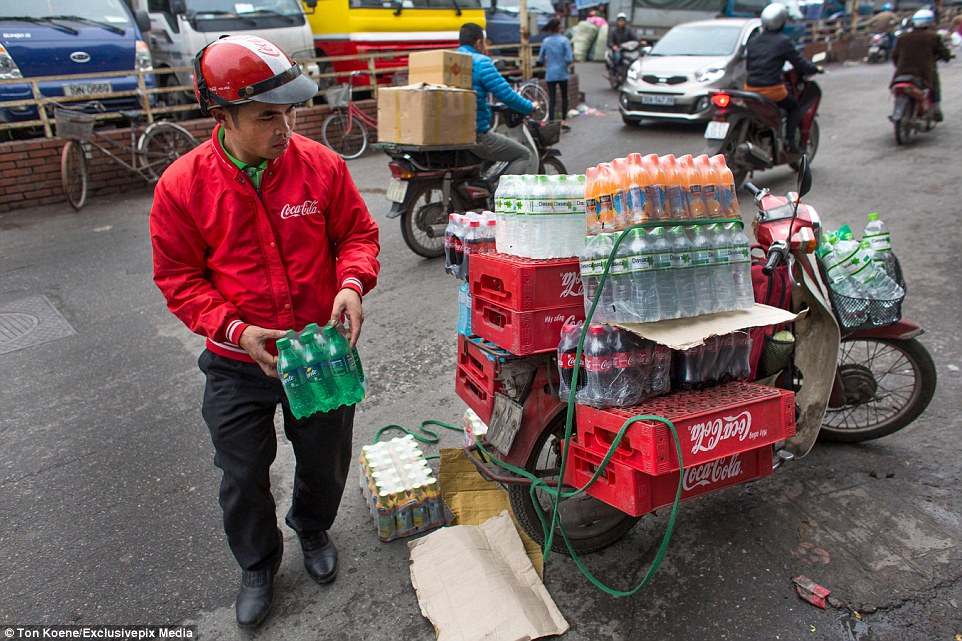 It's not just local delivery drivers who use motorbikes to get around; drivers for large companies such as Coca-Cola also use them