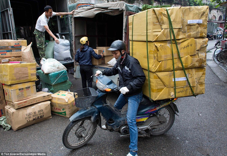 There's seemingly no measure to what can be packed onto the back of a bike or scooter in southeast Asia