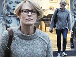 146177, EXCLUSIVE: Robin Wright dashes to her car in the rain, after a two hour hair salon visit at Luxe Lab in Brentwood. Brentwood, California - Saturday December 19, 2015. Photograph: © Gaz Shirley,PacificCoastNews. Los Angeles Office: +1 310.822.0419 sales@pacificcoastnews.com FEE MUST BE AGREED PRIOR TO USAGE