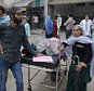 Patients who were shifted outdoors at the government medical college hospital after a strong tremor was felt in Jammu, India, Monday, Oct. 26, 2015. A strong earthquake in northern Afghanistan was felt across much of South Asia on Monday, shaking buildings from Kabul to Delhi and cutting power and communications in some areas. (AP Photo/Channi Anand)