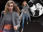 GiGi Hadid is seen leaving photo studios in london, the fashion model was then driven to Zayn Malik's 2 million pound hertfordshire house in barnet and drove into the driveway, the electric gates then closed and Gigi was then seen leaving alone 30 mins later.