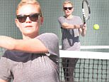 Picture Shows: Kirsten Dunst  December 21, 2015\n \n 'Fargo' actress Kirsten Dunst and a friend play a couple of games of tennis in Los Angeles, California. Kirsten had to gain weight for her role on 'Fargo' and is now trying to burn some of that weight off. \n \n Non-Exclusive\n UK Rights Only\n \n Pictures by : FameFlynet UK © 2015\n Tel : +44 (0)20 3551 5049\n Email : info@fameflynet.uk.com