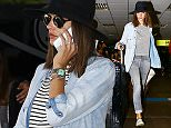 UK CLIENTS MUST CREDIT: AKM-GSI ONLY\nEXCLUSIVE: Florianopolis, Brazil - Alessandra Ambrosio gets picked up by her sister at the Airport. The Victoria's Secret mother-of-three returned to her hometown of Florianopolis to spend the Holidays with her family. She wore a stripped cropped top with a denim shirt on top, gray jeans and accessorized with a black  hat.\n\nPictured: Alessandra Ambrosio\nRef: SPL1199392  201215   EXCLUSIVE\nPicture by: AKM-GSI / Splash News\n\n