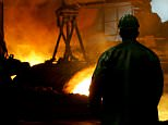 Picture taken 10 December 2004 shows a steel worker at the blast furnaces of Sollac Lorraine, an Arcelor's subsidiary in Hayange, France.  Arcelor directors have accepted a partnership offer from Mittal Steel, the Luxembourg economy minister and a spokesman for Mittal Steel said here Sunday 25 June 2006. The new company formed from the union of European group Arcelor and Mittal Steel will be called Arcelor-Mittal, Arcelor chairman Joseph Kinsch said Sunday, adding that Mittal had improved its offer to Arcelor by 10 percent.       AFP PHOTO FILES/JEAN-CHRISTOPHE VERHAEGEN (Photo credit should read JEAN-CHRISTOPHE VERHAEGEN/AFP/Getty Images) STEEL INDUSTRY WORKER ILLUSTRATION FACTORY BLAST FURNACE FOUNDRY JU MPSUIT VERTICAL INTERIOR VIEW MTZ4