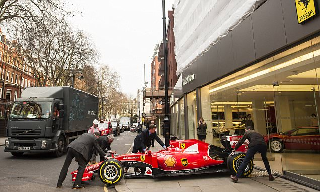 Ferrari rewards dealer with an F1 car but bedlam ensues getting it into the showroom
