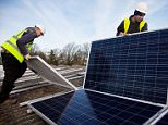 Andy Tyrrell and Jake Beautyman installing solar panels on a barn roof at Grange farm, near Balcombe, a village which was at the centre of protests against fracking and has moved a step towards becoming self-sufficient through renewable energy by installing the panels at two schools.   PRESS ASSOCIATION Photo. Issue date: Wednesday August 19, 2015. More than 50 local investors have helped pay for the panels which are being put up at Balcombe Primary School and Turners Hill School following a pilot scheme which saw 69 panels installed on a cowshed at Grange Farm. The village is also aiming to install a 5MW solar farm at nearby Chiddinglye Farm, West Hoathly, which would mean enough electricity produced to supply both Balcombe and West Hoathly. See PA story ENVIRONMENT Fracking Balcombe. Photo credit should read: Kristian Buus/10:10/PA Wire.  Embargoed to 0001 Wednesday August 19. Undated handout photo issued by 10:10.  NOTE TO EDITORS: This handout photo may only be used in for editori