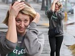 December 22, 2015: 'Big Bang Theory' star Kaley Cuoco gets caught in a light rain shower after getting her hair done at a salon in Sherman Oaks. \nMandatory Credit: Fresh/INFphoto.com Ref: infusla-284