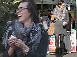 UK CLIENTS MUST CREDIT: AKM-GSI ONLY EXCLUSIVE: Milla Jovovich and her friends enjoyed a Sunday at the Melrose Place Farmers Market in West Hollywood. The model-turned-actress looked classy in a grey sweater dress with a plaid and fur scarf, fringed black boots and a pair of glasses.  Pictured: Milla Jovovich Ref: SPL1199677  211215   EXCLUSIVE Picture by: AKM-GSI / Splash News