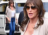 """Please contact X17 before any use of these exclusive photos - x17@x17agency.com   EXCLUSIVE - Caitlyn Jenner is sexy in a cleavage-baring white top, skinny jeans and heels as she arrives for a visit with daughter Kendall Jenner. Jenner also sports a monogrammed """"Caitlyn"""" necklace and looks like she has a sore on her right foot from all the fancy footwear she's been wearing. Monday, December 21, 2015. Castro/X17online.com"""
