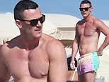 Luke Evans, 36, shirtless at the beach with his male friend in Miami Beach, FL. The Welsh actor enjoyed a morning swim in the ocean during his Florida holiday.\n\nPictured: Luke Evans\nRef: SPL1198964  211215  \nPicture by: Pichichi / Splash News\n\nSplash News and Pictures\nLos Angeles: 310-821-2666\nNew York: 212-619-2666\nLondon: 870-934-2666\nphotodesk@splashnews.com\n