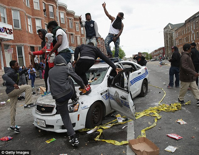 Protests: Demonstrators take part in violent protests following the funeral of Freddie Gray in Baltimore, Maryland, in April