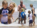 24 DECEMBER 2015 SYDNEY AUSTRALIA\nEXCLUSIVE PICTURES\nNaomi Watts pictured with her husband Liev Schreiber and sons Samuel and Sasha at Bondi Beach enjoying a swim and some family time.