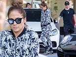 EXCLUSIVE: A make-up free Jennifer Lopez seen wearing sweats as she and boyfriend Casper Smart are seen shopping on Christmas Eve at Neiman Marcus in Los Angeles, CA\n\nPictured: Jennifer Lopez and Casper Smart\nRef: SPL1199504  241215   EXCLUSIVE\nPicture by: VIPix / Splash News\n\nSplash News and Pictures\nLos Angeles: 310-821-2666\nNew York: 212-619-2666\nLondon: 870-934-2666\nphotodesk@splashnews.com\n