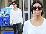 """Calabasas, CA - Kourtney Kardashian is one busy mom, today the mother-of-three made another trip to Toys """"R"""" Us in the Calabasas area. She wore a white sweater, and black leather trousers matching her booties and Givenchy tote.\nAKM-GSI         December 23, 2015\nTo License These Photos, Please Contact :\nSteve Ginsburg\n(310) 505-8447\n(323) 423-9397\nsteve@akmgsi.com\nsales@akmgsi.com\nor\nMaria Buda\n(917) 242-1505\nmbuda@akmgsi.com\nginsburgspalyinc@gmail.com"""