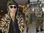 Mandatory Credit: Photo by Palace Lee/REX/Shutterstock (5501865c)  Rita Ora  Rita Ora at Heathrow Airport, London, Britain - 24 Dec 2015  Rita Ora arriving at Heathrow Airport from Hong Kong