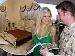 Baghdad, June 10, 2004. File - Entertainer Sophie Monk presents LAC Ken Taffe with an autographed photo in Baghdad Iraq, during Sophie's concert tour to entertain troops in the Middle East. (AAP Image/Australian Defence) NO ARCHIVING, EDITORIAL USE ONLY