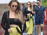 22.DEC.2015 - HAWAII\n*EXCLUSIVE ALL ROUND PICTURES - STRICTLY AVAILABLE FOR UK AND GERMANY USE ONLY*\nChrissy Teigen shows off her baby bump in a crop top and loose fitting yellow pants as her and John Legend go out to sushi while on their holiday vacation in Hawaii. \nBYLINE MUST READ : XPOSUREPHOTOS.COM\n***UK CLIENTS - PICTURES CONTAINING CHILDREN PLEASE PIXELATE FACE PRIOR TO PUBLICATION ***\n*UK CLIENTS MUST CALL PRIOR TO TV OR ONLINE USAGE PLEASE TELEPHONE 0208 344 2007*