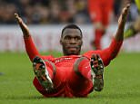 Liverpool's Christian Benteke reacts after a challenge during the English Premier League soccer match between Watford and Liverpool at Vicarage Road stadium in Watford, Sunday, Dec. 20, 2015. (AP Photo/Matt Dunham)