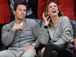 LOS ANGELES, CA - DECEMBER 23:  Mark Wahlberg (L) and Rhea Durham attend a basketball game between the Oklahoma City Thunder and the Los Angeles Lakers at Staples Center on December 23, 2015 in Los Angeles, California.  (Photo by Noel Vasquez/GC Images)