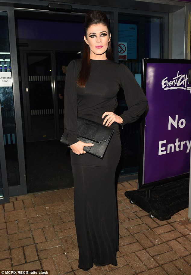 Elegant:Halloween may have been last month, yet Kym seemed nostalgic for the holiday as she dressed in the dramatic black gown which perfectly suited the night's theme